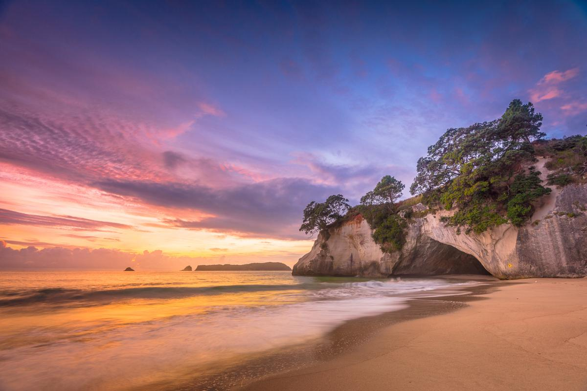 See the sun rise at Cathedral Cove